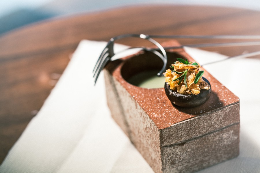 Champignon, onion, savory, cicely and mugwort served in a brick bowl by Deborah Rudolph with a '3D' fork by Nils Hint.