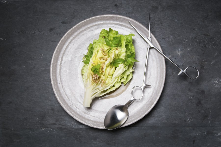 Lettuce, emmer and lovage served on a plate by Dirk Aleksic with a 'Scissors' spoon by Nils Hint.