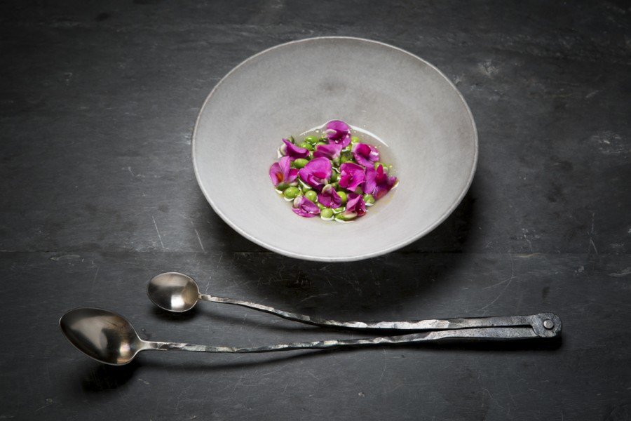 Onions, peas and camelina oil served on a plate by Dirk Aleksic with a double spoon by Nils Hint.
