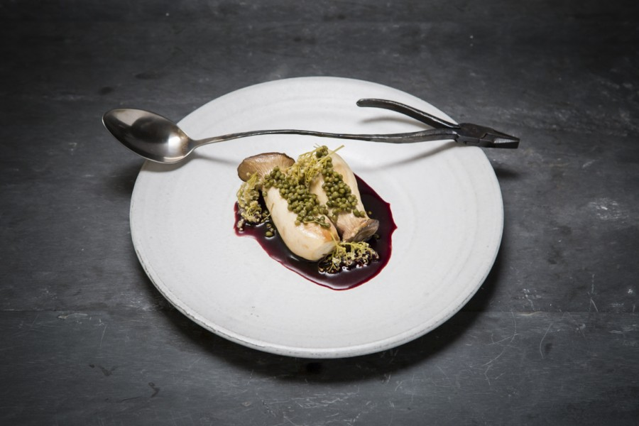 King trumpet and elderberry served on a plate by Dirk Aleksic with a 'Pliers' spoon by Nils Hint.