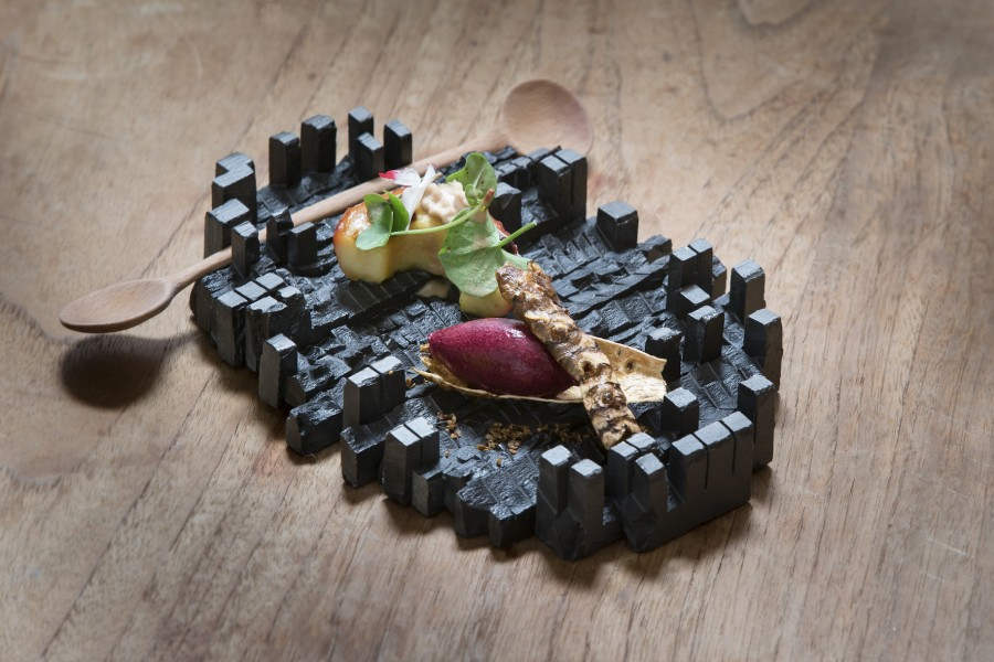 Grapes, apples, nuts, sunchoke and sorrel served on a slate plate by Matthias Dyer with a double spoon by Stian Korntved Ruud.