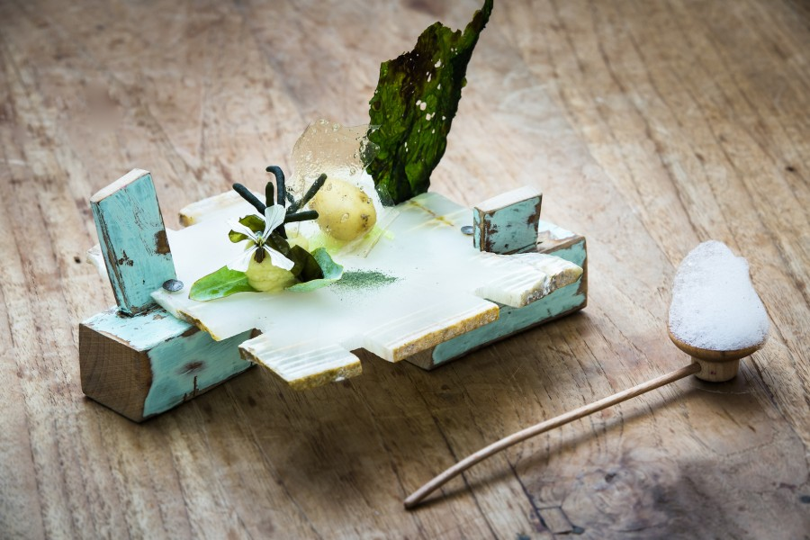Seaweed, potato, sea purslane, oyster leaf and leek served on the 'Puzzle Piece' plate by Tatjana Giorgadse with the 'Pipe' spoon by Stian Korntved Ruud.