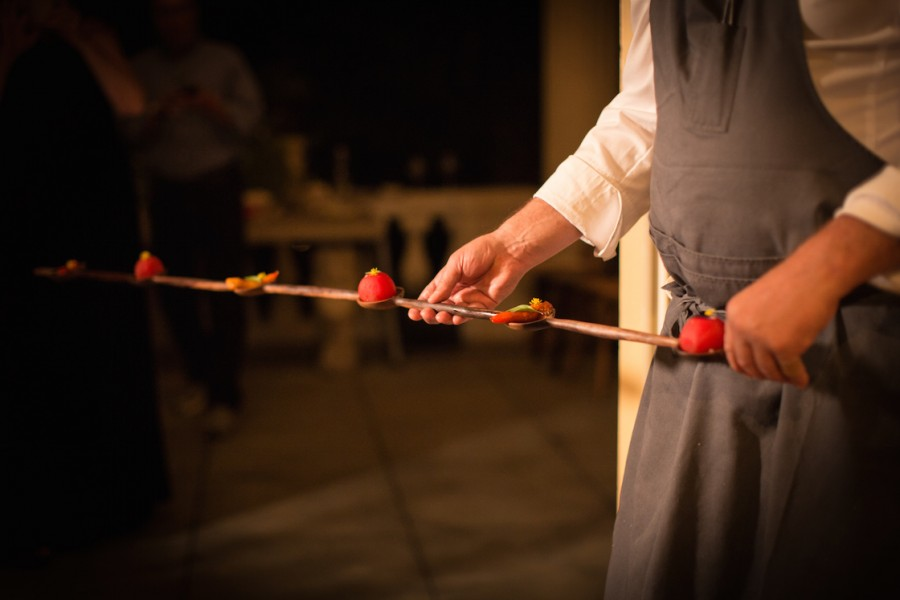 "David Kinch (Manresa) serving ""Petit Farcis"" epper and tomato on a sculptured walnut spoon by Julian Watts."