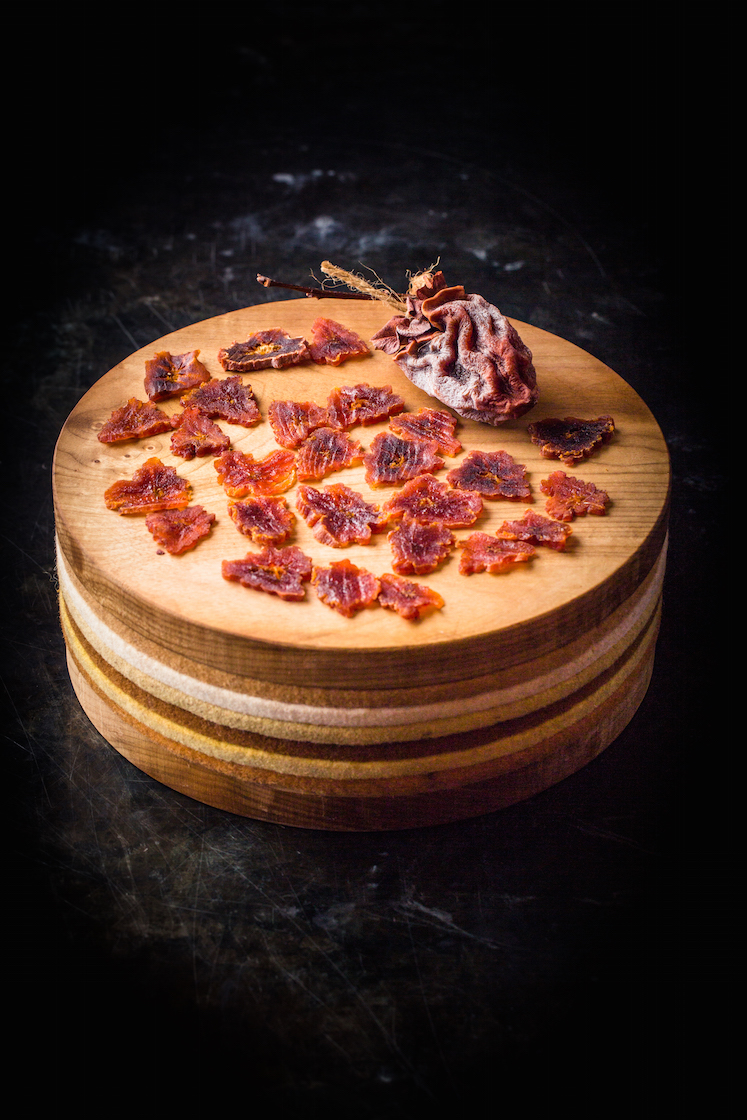 Air-dried Hachiya Persimmons (Hoshigaki) served on a big cake plate from culinary artist Andrea Blum.