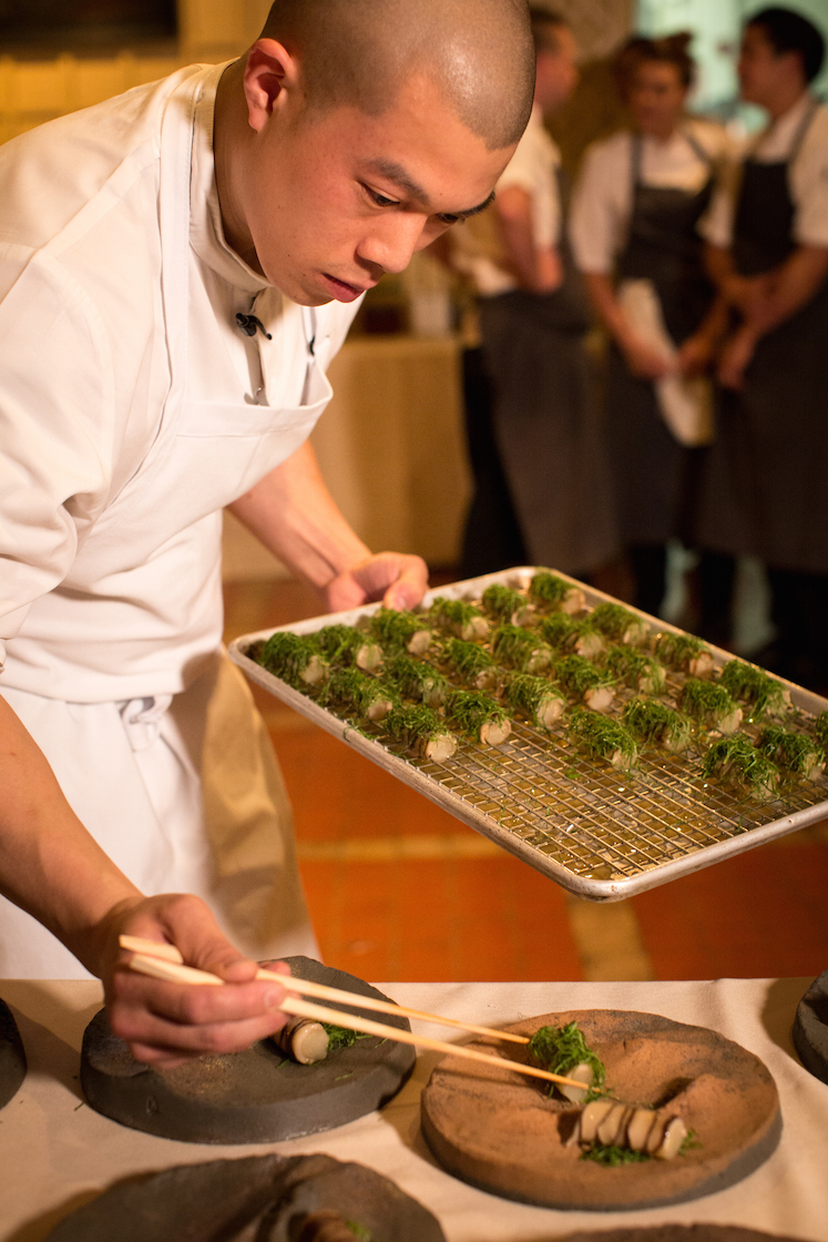 Team of chef Corey Lee (Benu) setting Eggplant, Shiitake, Sesame Leaf on landscape plates by Mitch Iburg.