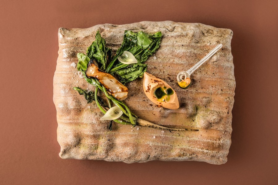 Spinach root, king oyster, miso and koriander served on a 'Pillow' plate by Tomasz Niedziolka and a 'Spoon-with-hole' by Gabi Veit. Photography by Tina Sturzenegger.