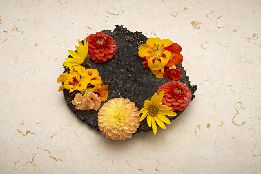 'Edible flowers' from Kristian Baumann (108) served on an organic soil plate by Rebecca Deans.