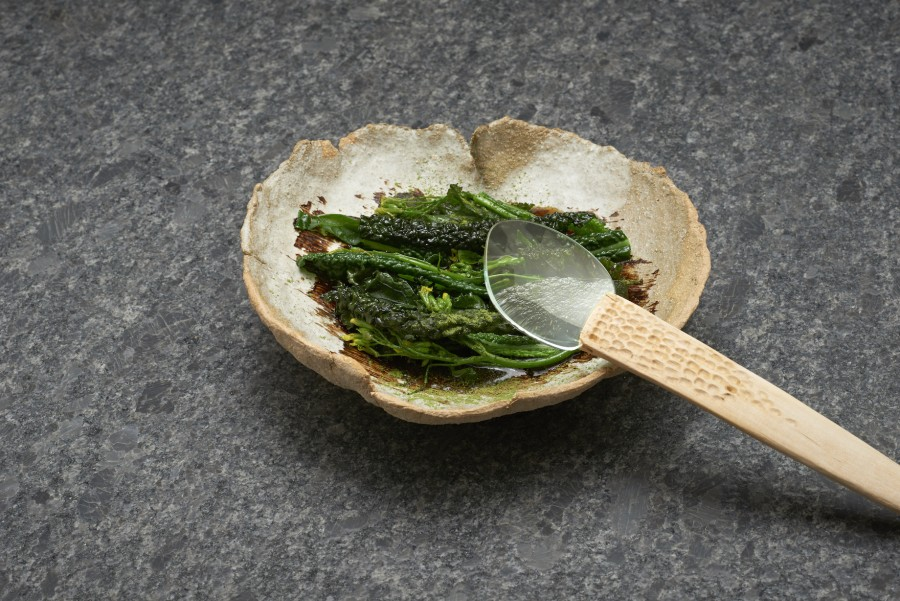 Kale, black garlic and lovage from Andreas Rieger (einsunternull) served on a ripped clay plate by Judith Lasry with an 'Optic' spoon by Elin Flognman.
