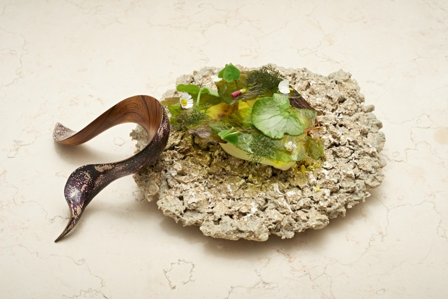 Salad with grape seed oil sorbet, vinegar and oil from Andreas Rieger (einsunternull) served on a 'Paper Pulp' plate by Caroline Hultqvist with a 'Moment' spoon by Joo Hyung Park.