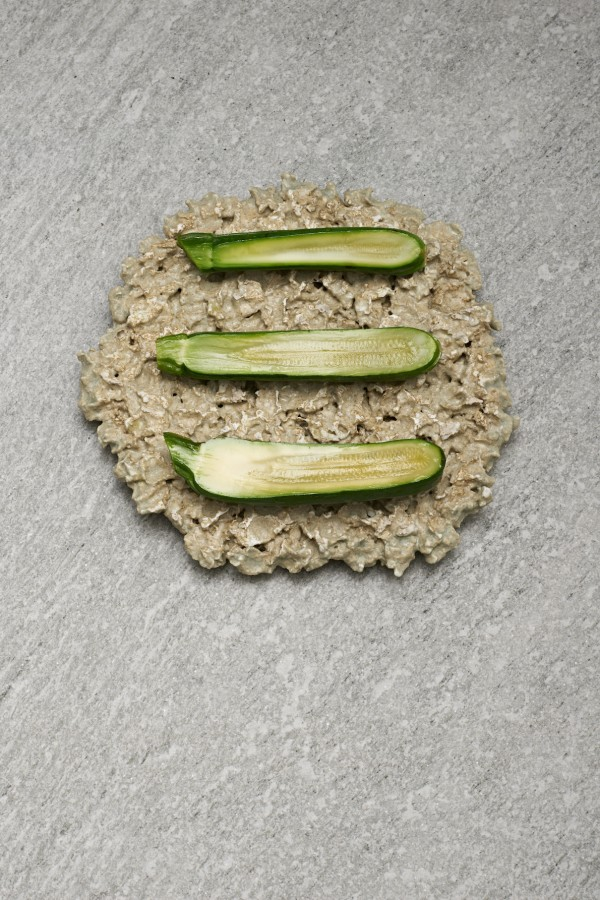 Sliced courgette and salted plums from Kristian Baumann (108) served on 'Paper Pulp' plate by Caroline Hultqvist.