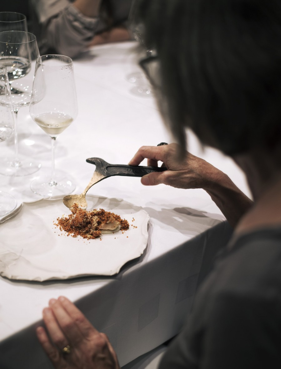 cauliflower couscous served on a leaves plate by Aino Nebel with a gold tool spoon by Nils Hint