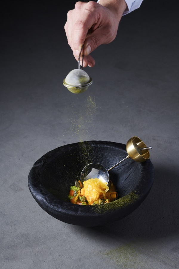 Muscat squash, spruce shoots emulsion, pickled spruce shoots, squash tagliatelle, spruce shoots pulver, squash puree by Fabian Raffeiner served on a burnt wood bowl by Othmar Prenner with a bell spoon by Stian Korntved Ruud
